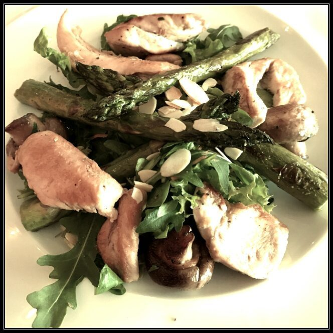 Canteen lunch - green salad with asparagus und grilled chicken breast